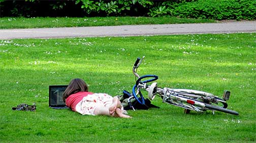 girl-on-grass-with-laptop