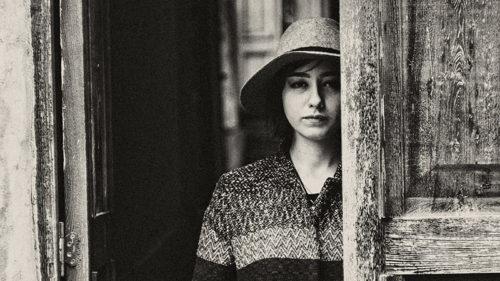 WOMAN-IN-DOORWAY